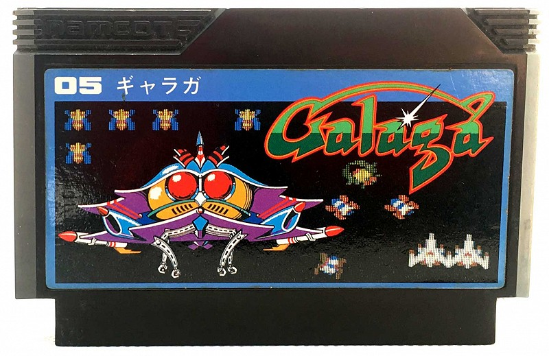 Photo of the black NAMCOT custom cartridge for Galaga for Nintendo Famicom