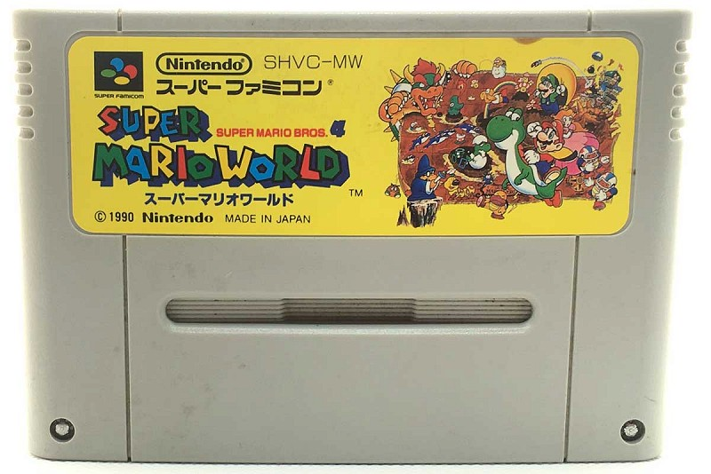 Photo of gray cartridge Super Mario World for Super Famicom